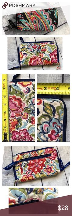Vera Bradley Floral/ Paisley Print Set Of Wallets Both wallets have zip around closure. One black with paisley print. The other is navy blue with a floral print. Both are in good condition with some wear around the edges of the fabric. Vera Bradley Bags Wallets