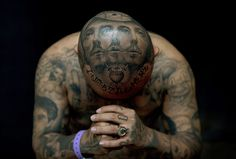 London: 'Oldies' poses for a photograph to display his tattoos by artist Josh Lin during the 8th International London Tattoo conventionPhotograph: Adrian Dennis/AFP