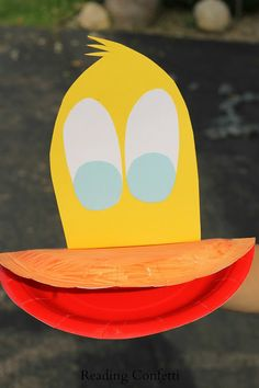 Kids can make a simple duck puppet from a paper plate