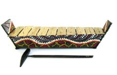 """Meditation Chime Energy Chime Wood Xylophone Angklung Instrument by World Bazaar Imports. $25.99. Fair Trade Item. Handcarved by skilled artisans. Features Nice Tribal Motifs. Produces A Nice, Resonating Sound. Perfect For Any Music Lover. Materials: Wood & Metal  Dimenions: Approx: 15""""L x 4""""H x 4.5""""D  Playing stick: 9""""L x 3.5""""D  Pattern may vary from the picture according to the artist's inspiration. Handmade - Please allow for minor variations. Save 26% Off!"""