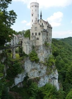 The fairy tale lichtenstein castle with its white watchtower in the Black Forest in Germany Stock Photo