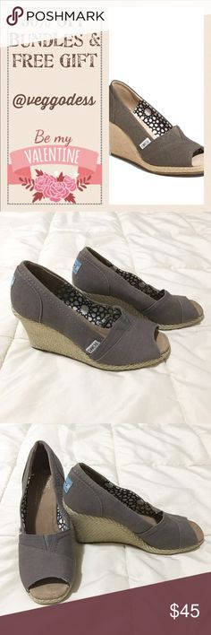 "💞30% off Bundles💞 💕MAKE AN OFFER💕 Toms Shoes Wedge Ash Grey Canvas Shoes. Pre-loved and lots still to offer! Check out the women's Toms Wedge shoe, featuring a durable canvas upper, a star design inside, and a braided twine wrap around a 3"" wedge. Tiny baby indent in back of left heel. Bundle discount of 30% through valentines...check out the rest of my closet. Free token gift 🎁 with each order. TOMS Shoes Wedges"