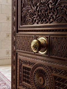 carved door- Spanish style with one big knob in the middle.