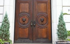Amazing double solid regency doors with lions head pulls | 973 5th Ave | M. Frederick Interiors