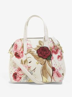 """Beauty is found within. But after looking at the exterior of this gorgeous Loungefly satchel, we're thinking beauty is found pretty much everywhere it goes! Cream-colored bag with a floral accented image of Belle on one side and a branded plaque and verbiage on the other. Gold tone hardware, removable strap and PU rose charm. Interior features drop and zip pockets with a polka dot print lining. Limited to 1,000 and numbered! 13 1/2"""" x 10"""" PU Imported"""