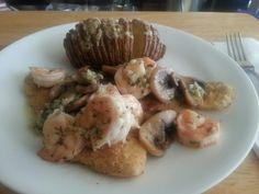 Shrimp on Sole with a Sliced Baked Potato.