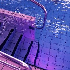 image description: stairs into a pool lit by pink and blue lights Violet Aesthetic, Lavender Aesthetic, Aesthetic Colors, Retro Aesthetic, Aesthetic Pictures, Water Aesthetic, Aesthetic Black, Music Aesthetic, Aesthetic Fashion