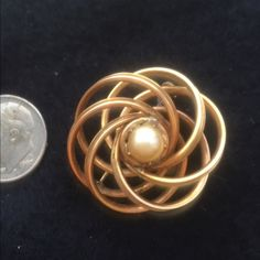 Vintage 1950s signed HG gold filled brooch w/pearl Vintage 1950s signed HG (probably Henry Griffith) gold filled brooch w/ pearl   1 inch in diameter.   Marked on back.  1/20 g.f.  H.G.  Excellent vintage condition. Vintage Jewelry Brooches