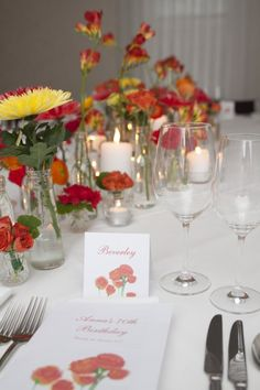 Floral Design by Event Scene Adelaide.  Hand painted design for the place cards and menus to match the floral set-up.