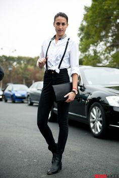 Borrowing from the boys is better! She's wearing a men's button-down, American Apparel suspenders, and Edun boots. She completes the combo with a Cos clutch.