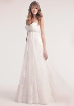 It's so simple, but the empire waist, sweetheart neckline and lace make it perfect.