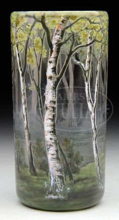 """DAUM ENAMELED BIRCHES TUMBLER/VASE. Daum vase is beautifully enameled with birch trees rising from green grass ground with pond and forests in distance. All against clear glass background. Signed on underside with gilded etched mark """"Daum Nancy"""" with cross of Lorraine."""