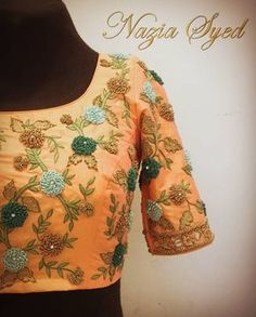 Knotted in Peach and Teal !! Stunning designer blouse with floret lata hand embroidery french knot work. 06 November 2017