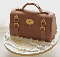 Cake Central - Alexa Mulberry Bag - 3D sponge cake covered in fondant and details in gum paste