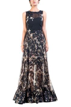 Featuring full length gown with printed organza flair. The lining inside is knee length, giving the dress a dreamy transparent look. The yoke has been embellished with monotone leather and contrasting