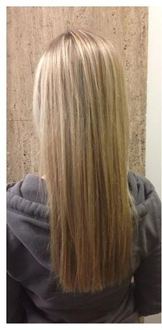 Long straight hair w/low lights. Light brown lowlights break up the colour & gives blonde hair color a finished look