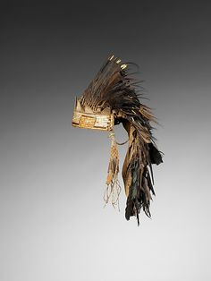 Feather Headdress Date: 1750–1800 Geography: United States, Eastern Plains or Western Great Lakes Culture: Eastern Plains or Western Great Lakes Medium: Raven feathers, porcupine quills, native-tanned leather, deer hair, metal cones