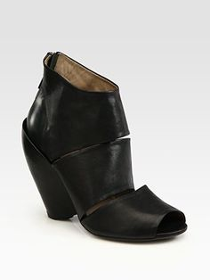 I was a bit slow to the party, but I'm starting to like chunky, cut-out booties. Here, Elisanero Leather Cutout Peep Toe Ankle Boots.
