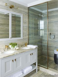 Silver travertine tiles, Ann Sacks's Palladium, line the walls and floor of the master bath.