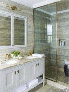 Silver travertine tiles, Ann Sacks's Palladium, line the walls and floor of the master bath.