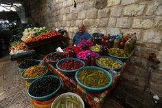 A Palestinian vendor waits for customers in the old market during preparations for the Muslim festival of Eid al-Adha, in the Old City of Nablus, October 2, 2014. Muslims around the world are preparing to celebrate the Eid al-Adha feast by slaughtering cattle, goats and sheep in commemoration of the Prophet Abraham's readiness to sacrifice his son to show obedience to God. (EPA/ALAA BADARNEH)