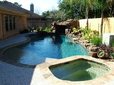 Built in hot tub in ground swimming pool spa floating for Pool design katy tx