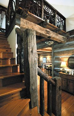 heart pine floor and hand hewn beams and tobacco pole bannister