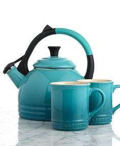 Tea up. A go-to gift idea, this mug & kettle set boasts a brilliant palette of Le Creuset's signature hues, plus, all the convenience and handcrafted excellence of the renowned French name. A stylish
