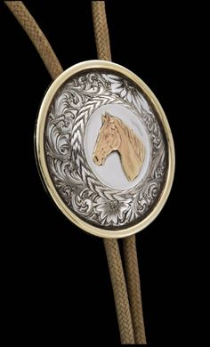 Beautiful 14K gold horsehead dominates the sterling concha of Alderson's bolo tie. Pablo Lozano created the braided rawhide cord with a 16-plait fl...