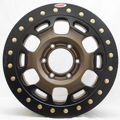 Here's a shot of the Toyota Rock Crusher wheel in a Bronze finish, with our Phaze 6 Beadlock Ring in Semi Gloss Black. Jeep Wheels, Truck Wheels, Toyota Tacoma Trd, Toyota Tundra, Ford Ranger Truck, Tyre Companies, Truck Mechanic, Jeep Mods, Truck Tyres