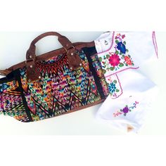 Ixchel Triangle diaper bag and embroidered girls dress. 100% handmade, and signed by the maker!