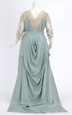 Pale blue faille gown. Made by dressmaker Madame Rose H. Boyd, Minneapolis, Minnesota. Use: Not earlier than 1913 - Not later than 1917 Accession file note indicates that this dress was worn at a wedding ca. 1916 Back view
