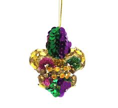 "Beaded and sequin design 2.5"" X 2"" Each made individually. Purple, Green & Gold colors Styrofoam base Texture differences may appear on this handcrafted item are inherent to the natural materials and"