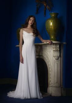 Scoop neck Crinkle Chiffon modified mermaid gown with front cowl neckline and open back.