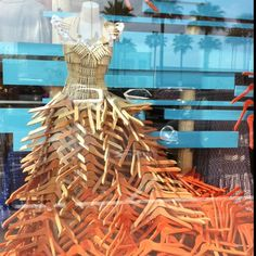 Anthropologie window display of gown made from clothespins and hangers