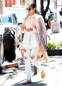 Vanessa Hudgens wears distressed white jeans with a button-down blouse, blush-pink coat, and nude ballet flats