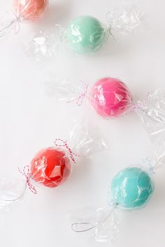 "DIY Candy Ornaments...""Wrap some ornaments up like giant candies and BAM! You've got the perfect holiday party favor! (Or just some awesome ornaments for your tree!)"""