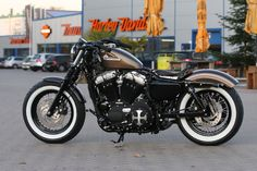 Customized Harley-Davidson Sportster 48 with whitewalls and leather saddle by Thunderbike Customs Germany