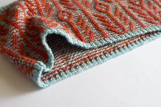 Ravelry: Etta's Xuxa. Wow.  Note: oops this is not twined knitting, raised pattern achieved by slip stitching...checked Ravelry page...