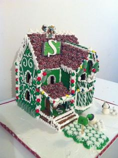 Saskatchewan Roughrider Gingerbread House - I made this Gingerbread house for my daughter's school for a fundraiser. Put together with Royal Icing, decorated with royal icing and loads of candy Gingerbread Man Cookies, Gingerbread Houses, Go Rider, Molasses Cake, Saskatchewan Roughriders, Christmas Gifts, Christmas Decorations, Royal Icing Decorations, Frosting Tips