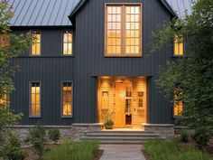 Grey House With Black Roof. Exterior house colors with black roof, charcoal grey houses with metal roof. Grey house with red door. Dark Grey Houses, Dark House, Style At Home, Modern Farmhouse Exterior, Farmhouse Style, American Farmhouse, Farmhouse Design, Fresh Farmhouse, Farmhouse Front