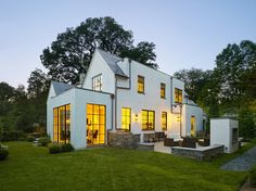 Updated classic American.  White stucco with large steel paned windows.