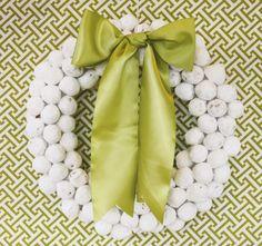 Christmas Dessert Table & Cocoa Bar {+ FREE Printables} with powdered sugar doughnut hole wreath, greek key pattern fabric backdrop, & coffee filter garland.