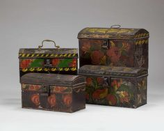 FOUR AMERICAN PAINTED TINWARE DOME-TOP TRUNKS, THREE WITH FLORAL DECORATION AND THE OTHER WITH CENTRAL SHELL. http://www.artfact.com/archives   (notice the rickrack on the top left one)