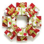 A #wreath made from wrapping paper is an innovative and unusual holiday decoration!