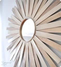 mirror made out of paint stirrers and a cross stitching hoop? looks so easy and cute!