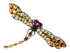 Breite: ca. 13 cm. Länge: ca. 7,5 cm. Gewicht: ca. 49 g. Geschwärztes WG 750. Hochdekorative Libellenbrosche mit facettierten orangefarbenen und gelben...