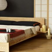 The hand-built Kulu platform wooden bed is a solid timber, modern low bed with optional attached side tables. UK made. Free UK Delivery. Buy online.