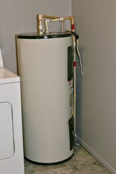 Laundry Room Closet With Water Heater - I shared that I wanted to hide my ugly hot water heater in my laundry room with you a few weeks ago.  #laundryroomcloset #waterheater #laundryroomclosetwithwaterheater #laundryoomwaterheater