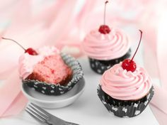 Blogger Heather Baird of  SprinkleBakes shares a recipe for scratch-made cherry cupcakes that are a great addition to a summer picnic or any dessert table!